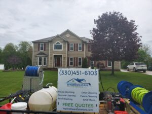 Professional pressure washing trailer in front of clean house in Akron Ohio